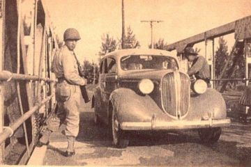 During WWII Pompano Beach and much of Broward was used for training soldiers heading off to Europe. In this picture, soldiers stop a vehicle crossing the Atlantic Blvd. Bridge. Courtesy: Pinterest