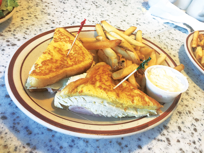 A turkey melt with fries at Olympia Flame in Deerfield Beach.