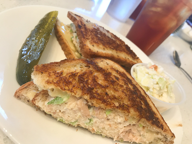 A tuna melt and a pickle spear at Lester's Diner in Pompano Beach.