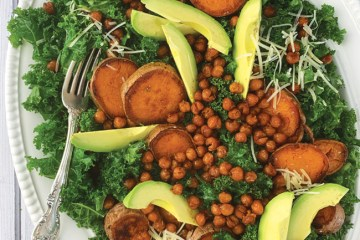 Kale Salad with roasted sweet potatoes, crispy chick peas and avocado with a creamy tahini dressing