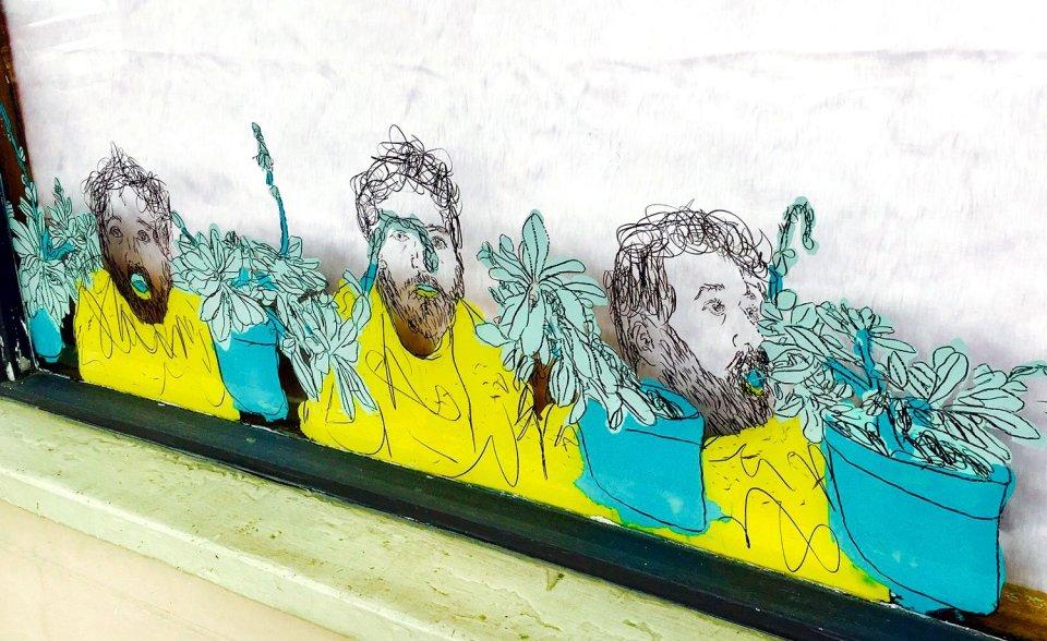 Window painting by Jon Levy-Warren beside Osteria Stellina