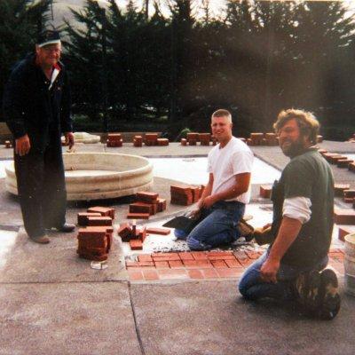 Three Giacomini men building the inn.