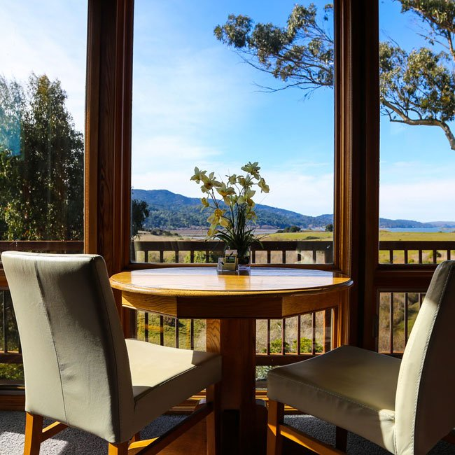 View of sky and trees and mountains from the dining room of Grand View suite.