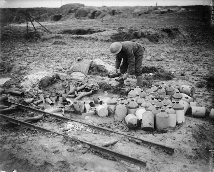 British soldier sifting through rum jars and shell cases.  Pozières, December 1916 © IWM (Q 4627)