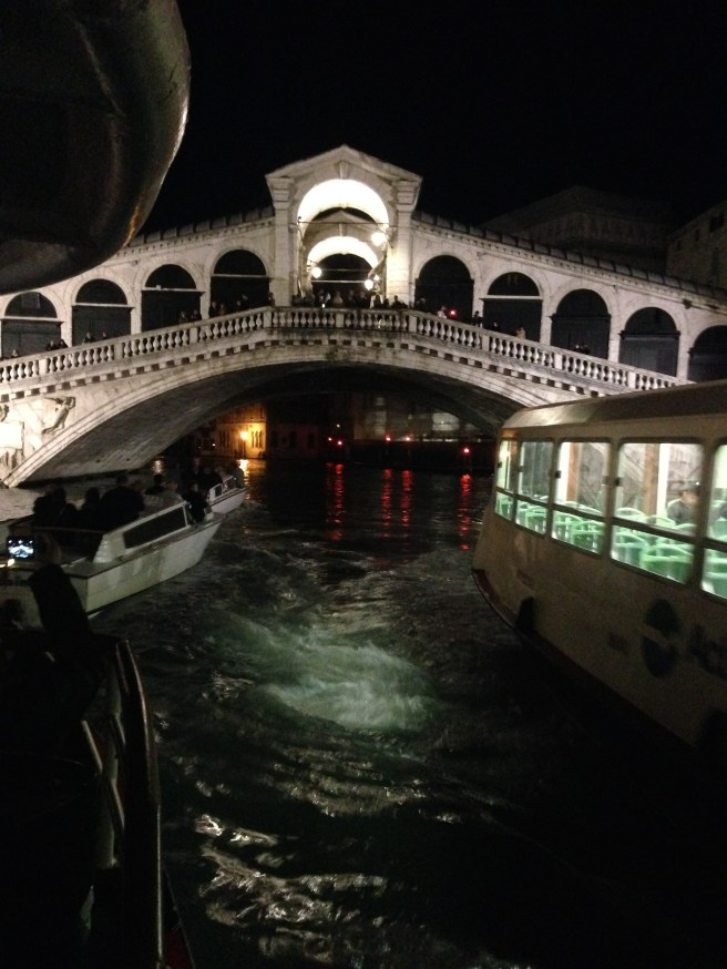 Grand Canal traffic at night under Rialto