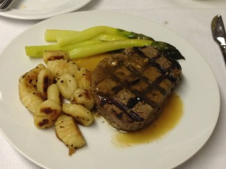Beef tenderloin with an asiago broth with brown butter gnocchi and green asparagus