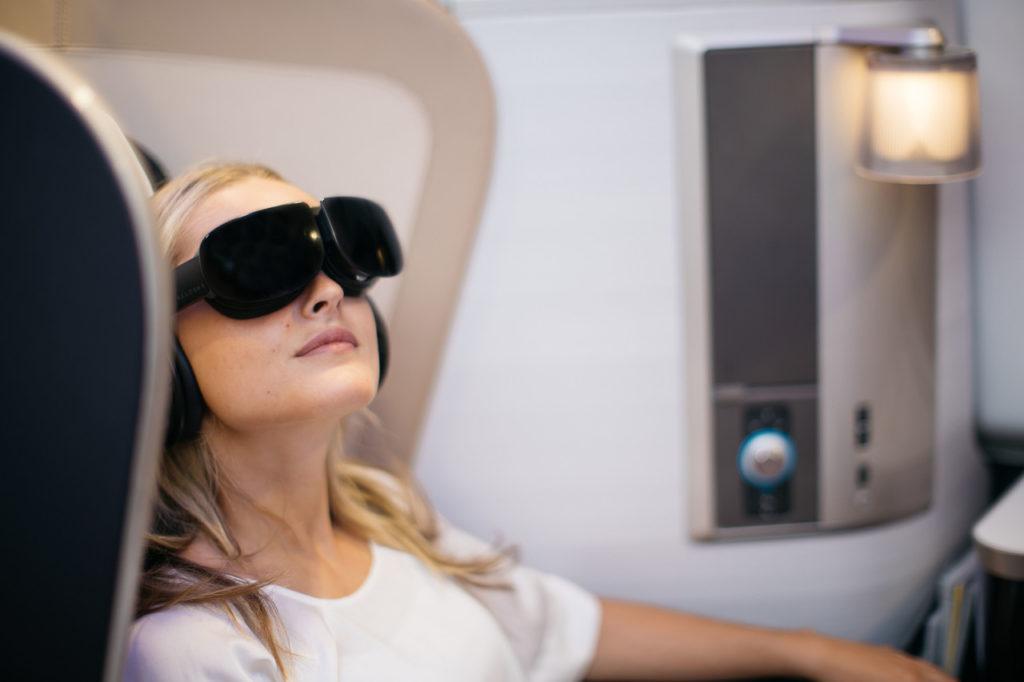 First Class passenger wearing a virtual reality headset
