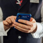 British Airways cabin crew using iPhone XR during a flight
