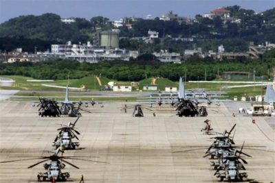 A general view of the U.S. Futenma Marines air base in Ginowan on the southernwestern Japanese island of Okinawa is seen in this July 16, 2000 file photo. Japan and the United States have reached an agreement on the touchy issue of funding the relocation of U.S. Marines to Guam, Japanese Chief Cabinet Secretary Shinzo Abe said on April 24. The deal paves the way for wrapping up a plan to reorganise the approximately 50,000 U.S. military personnel in Japan, part of Washington's global strategy to make its forces more flexible to meet modern threats. REUTERS/Kimimasa Mayama/Files