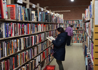 People browsing book shelves in book store