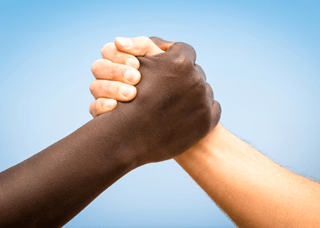 Image of hands together in solidarity - one black and one white