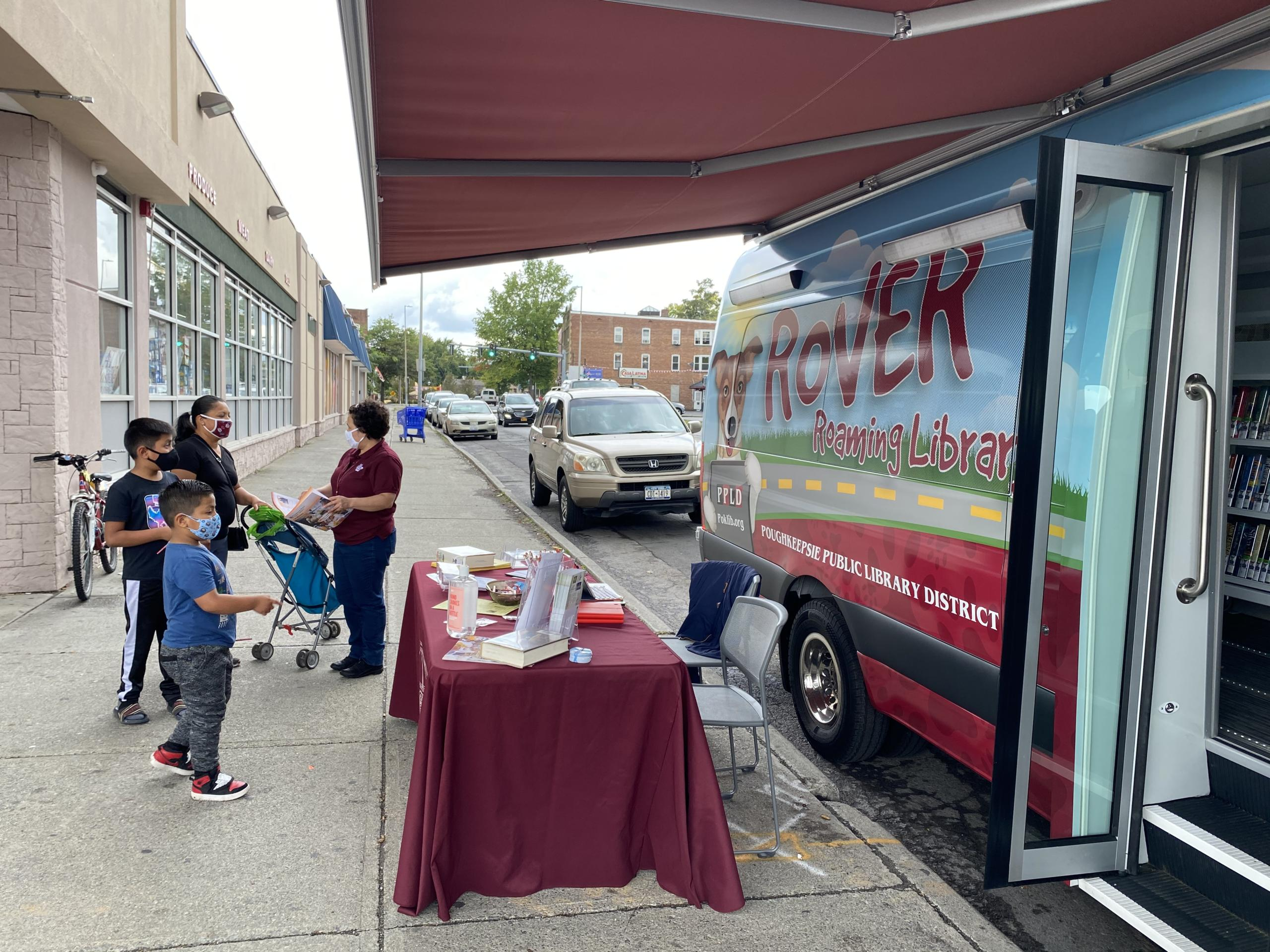 Photo #3 of Rover bookmobile at Fresh Market.