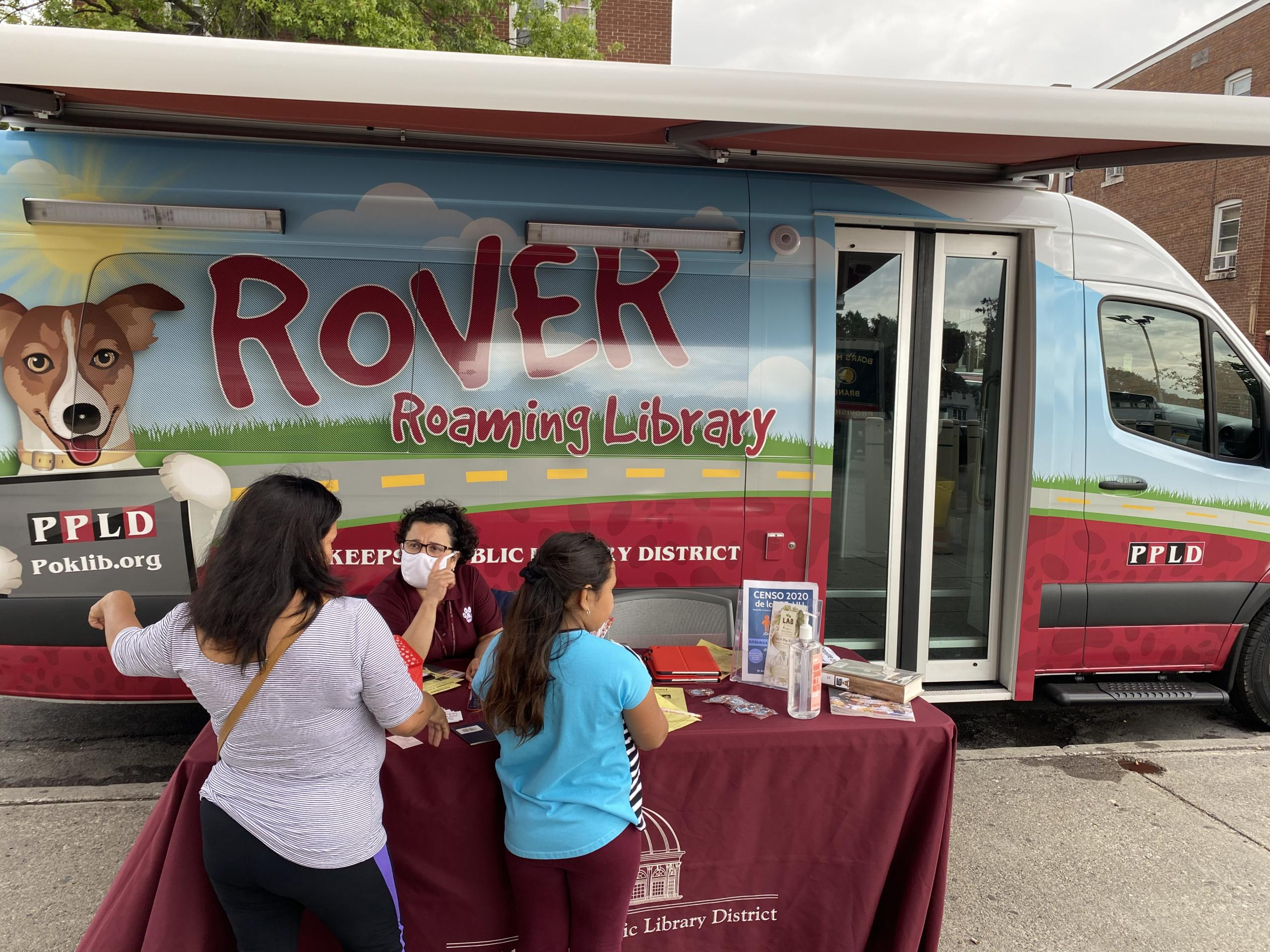 Photo #1 of Rover bookmobile at Fresh Market.