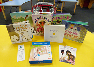 Image of an Early Literacy Backpack with books and an activity sheet