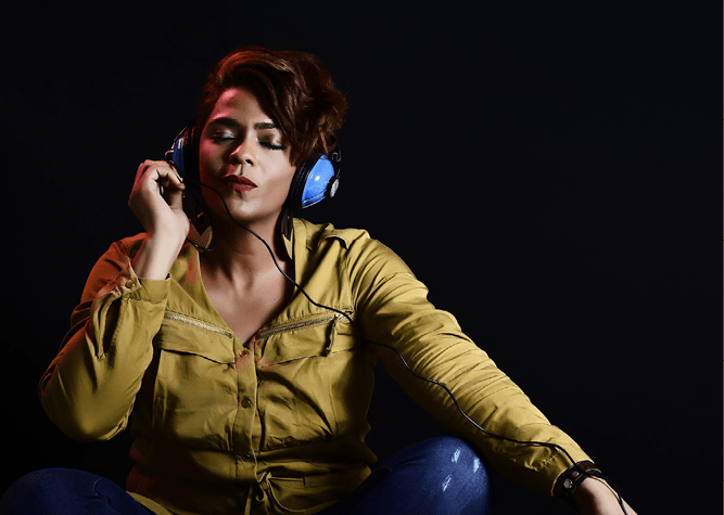 Image of woman listening to music on headphones