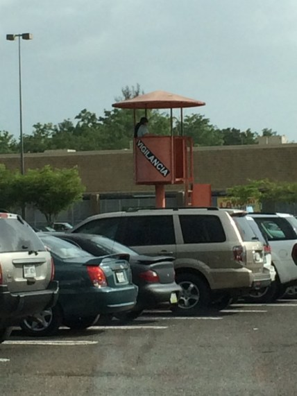 These people sit in towers around the Walmart parking lot, watching for....?