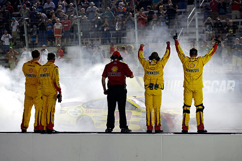 Logano holds off Harvick to defend Bristol title