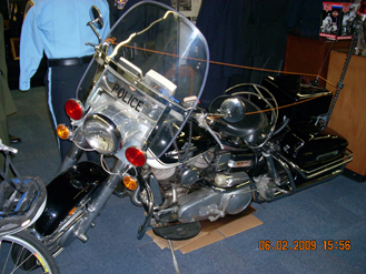 """A 1965 Harley Davidson Electra-Glide """"Police Special"""" formerly in the fleet of the Newport, Kentucky, Police Department. The odometer shows 39,000 miles."""