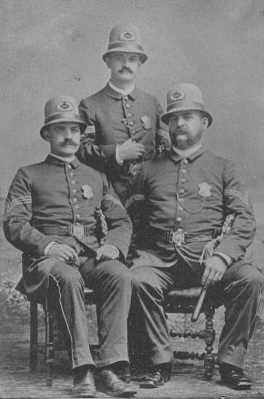 "The sergeants of Cincinnati's Fifth Police District in 1890: John H. Kiffmeyer, Louis Schmitt, and Edward C. ""Doc"" Hill. Sergeant Hill was called upon to portray Santa Claus at Christmas."