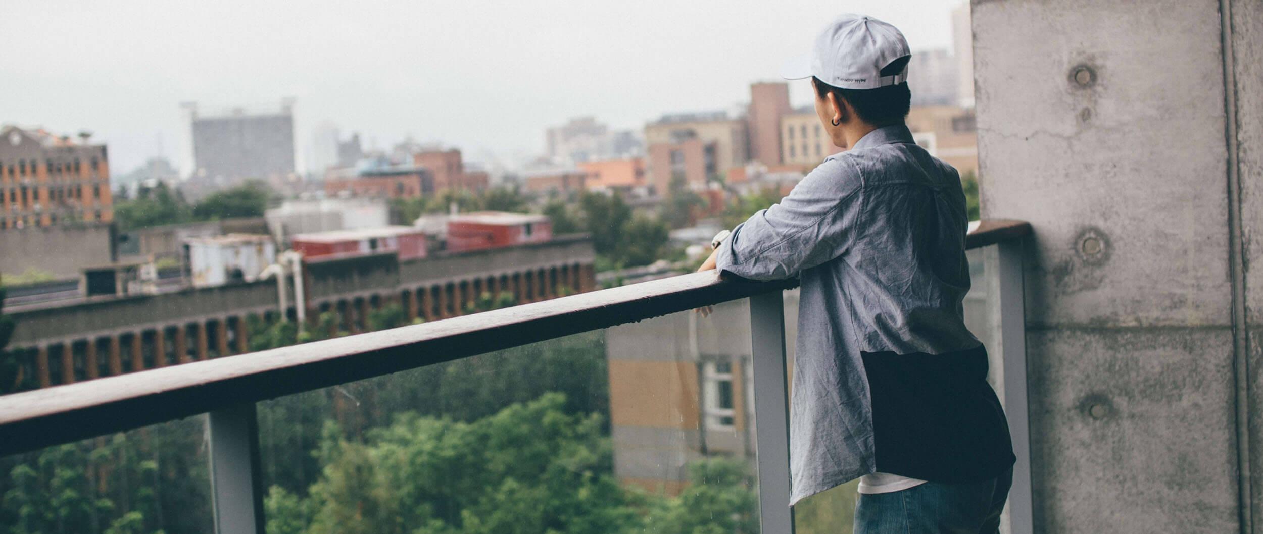 Unsplash Boy on Inner City Balcony
