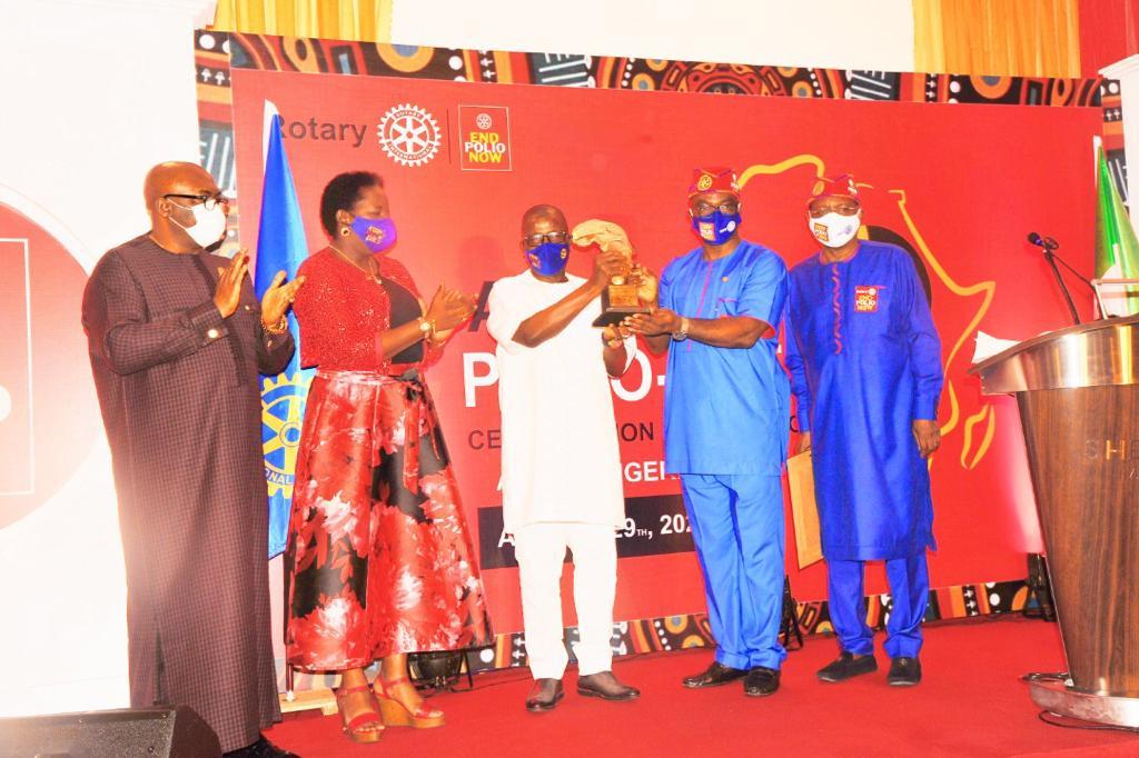 Sir Emeka Offor receives an award on behalf of Sir Emeka Offor Foundation