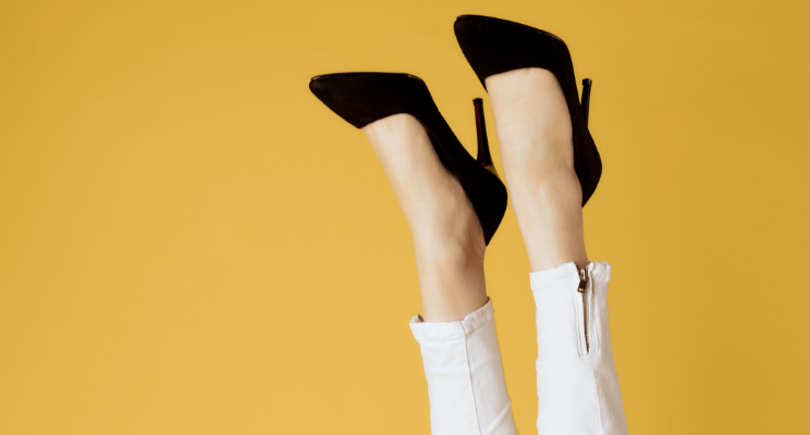 Best Nordstrom Anniversary Sale Picks You Need to Shop ~ Image of closeup of woman wearing black pumps and white ankle jeans in front of a yellow background