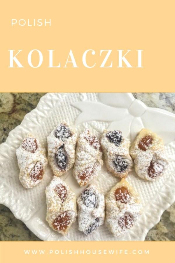 fruit filled kolaczki cookies on a white plate on a granite slab