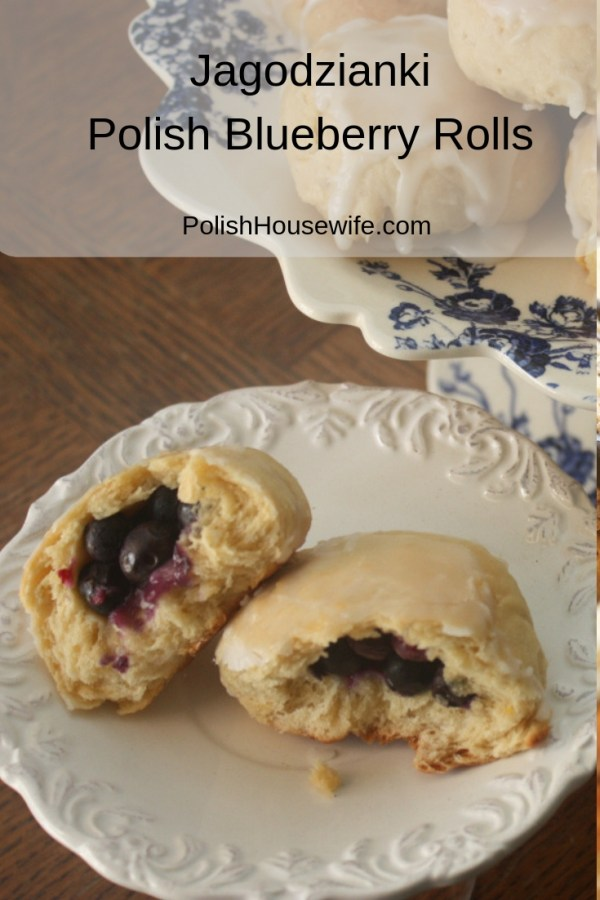blueberry filled yeast rolls with glaze on a white saucer and a cake stand