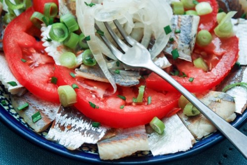 pickled herring with tomato and onions