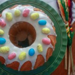 easter babka on green cake plate with candy eggs on top