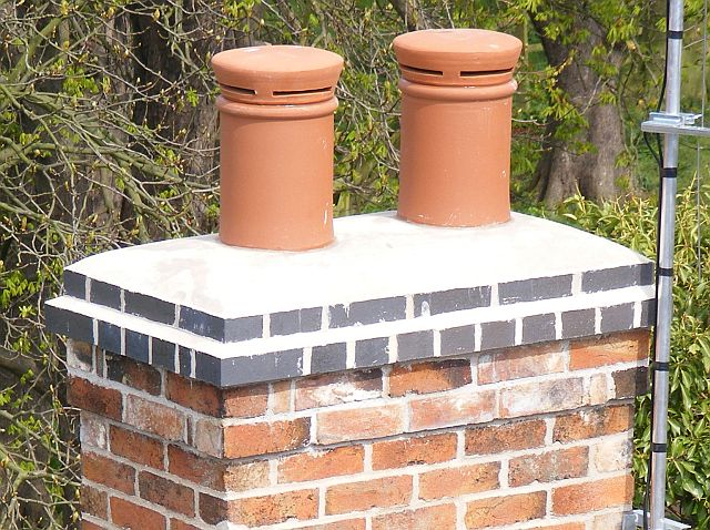 chimney stack with new brickwork and blue brick cap