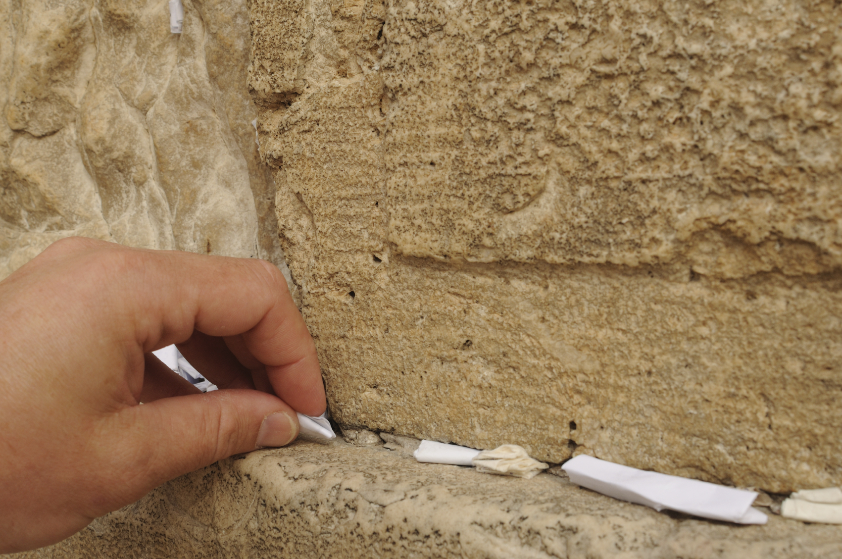 A paper petition into the Western Wall.