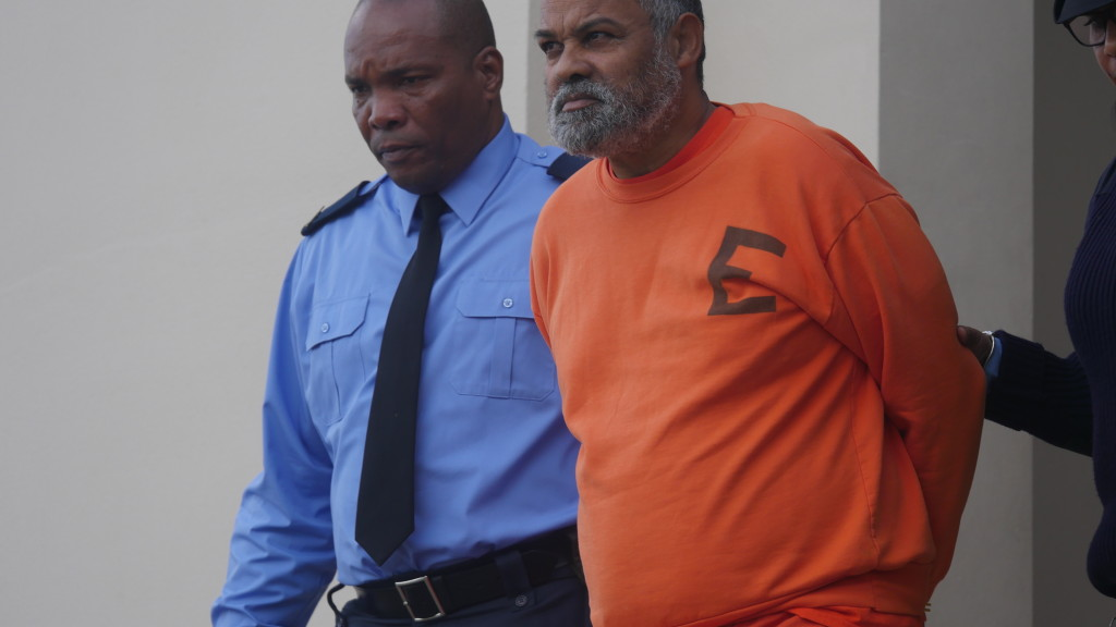 Alan Robinson being escorted from court last week