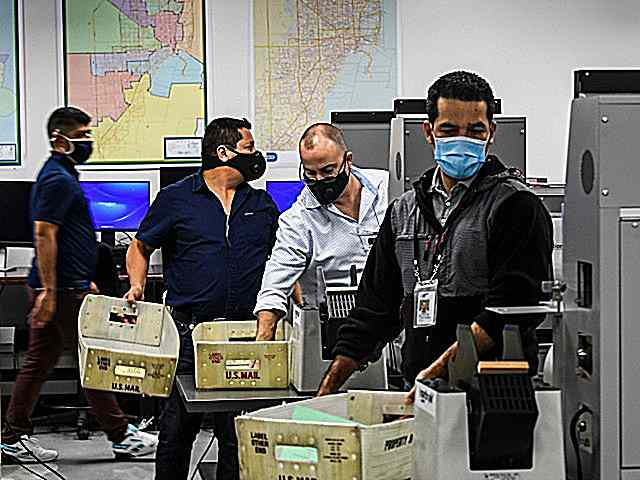election-workers-masks-scan-ballots-getty.jpg