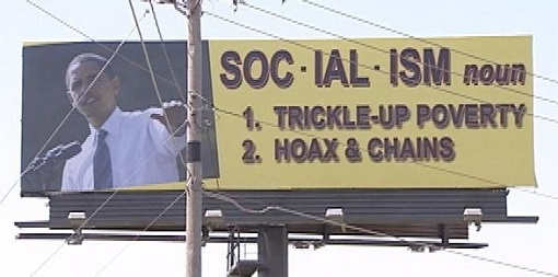 obama-sign-socialism-trickle-up-poverty-hoax-and-chains