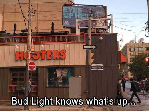 hooters-bud-light-sign-eyes-up-here