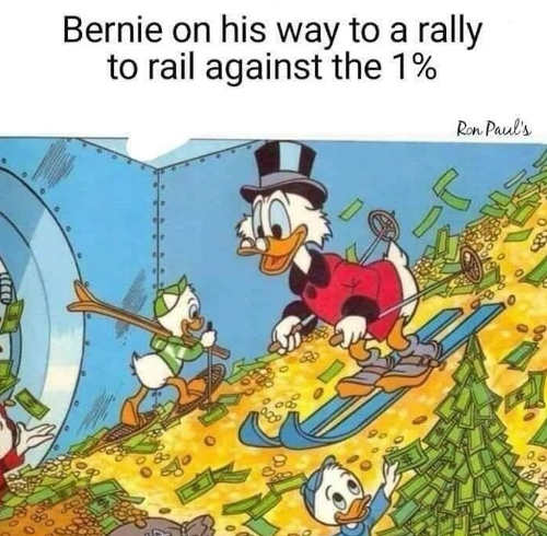 bernie sanders on his way to a rally against the 1 percent donald duck