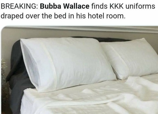 bubba wallace finds kkk uniforms draped over bed in hotel room