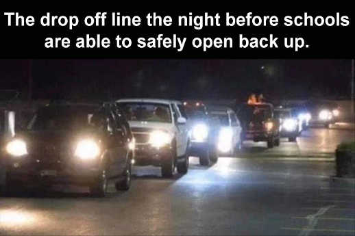 cars lined up drop off line night before schools open back up