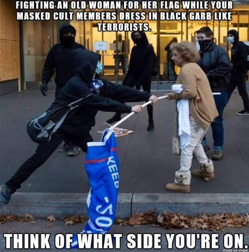 message antifa fighting old woman for flag while cult members dress black garb think what side youre on