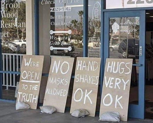 sign open no masks allowed handshakes hugs ok