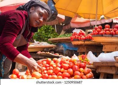 Photo of a food trader at a market