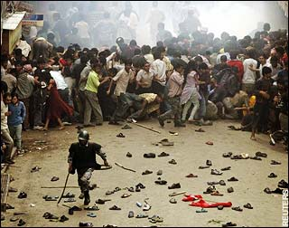 Nepal riot policeman runs away from protesters