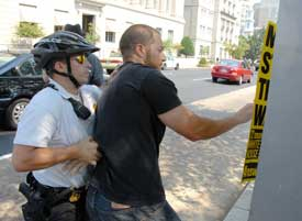 Arrest in DC for putting up antiwar posters