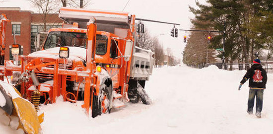 Snow plow stuck, tire spun off. Credit: courant.com