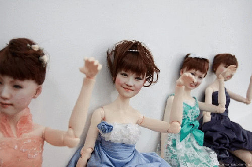 The bodies are plastic. The heads are 3D printed. Seriously.