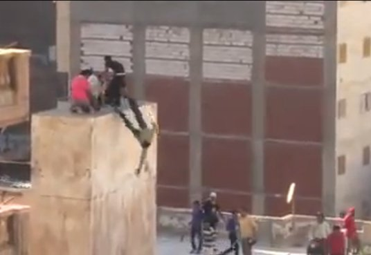 Still from video appears to show anti-Morsi supporters trapped, knocked from rooftop, beaten