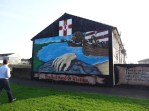 Mural about a race to Ireland between 2 brothers, winner cut off his hand and threw it onto land