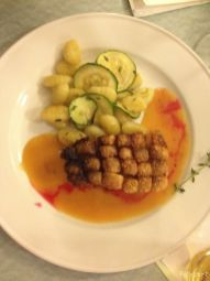 12 hour oven roasted pork, with blood orange gravy, thyme gnocchi and zucchini