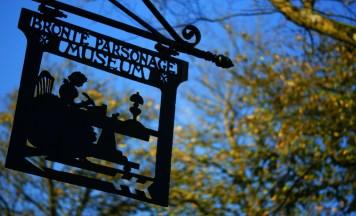 Metal sign outside the Brontë Parsonage Museum, Haworth, West Yorkshire.